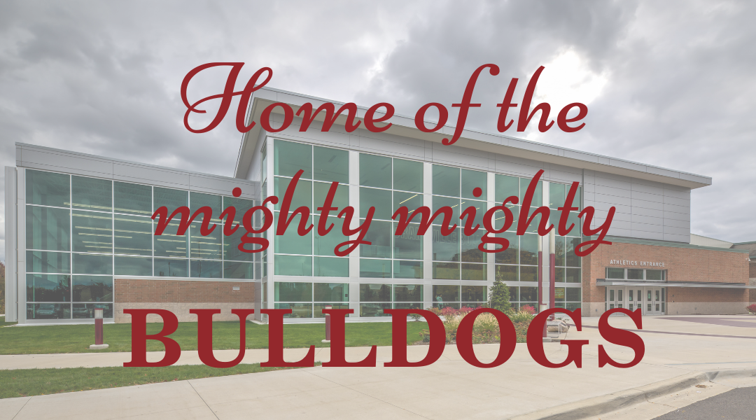 exterior of high school entrance with text over Home of the mighty mighty bulldogs