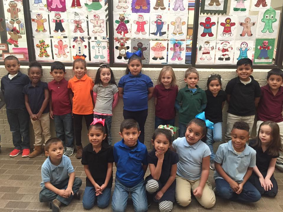 KG students posing with their gingerbread man art