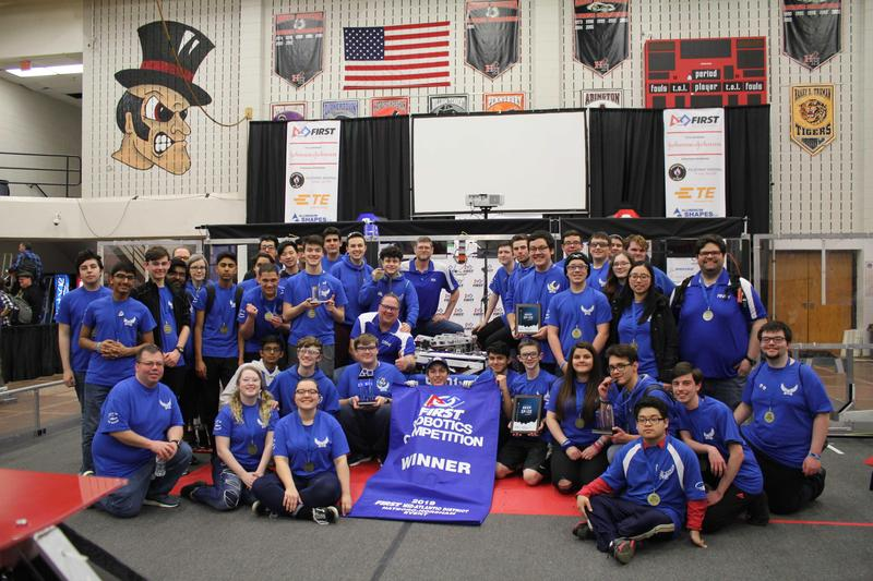 BHS Robotics Team 5401 holding their awards, dressed in blue t-shirts