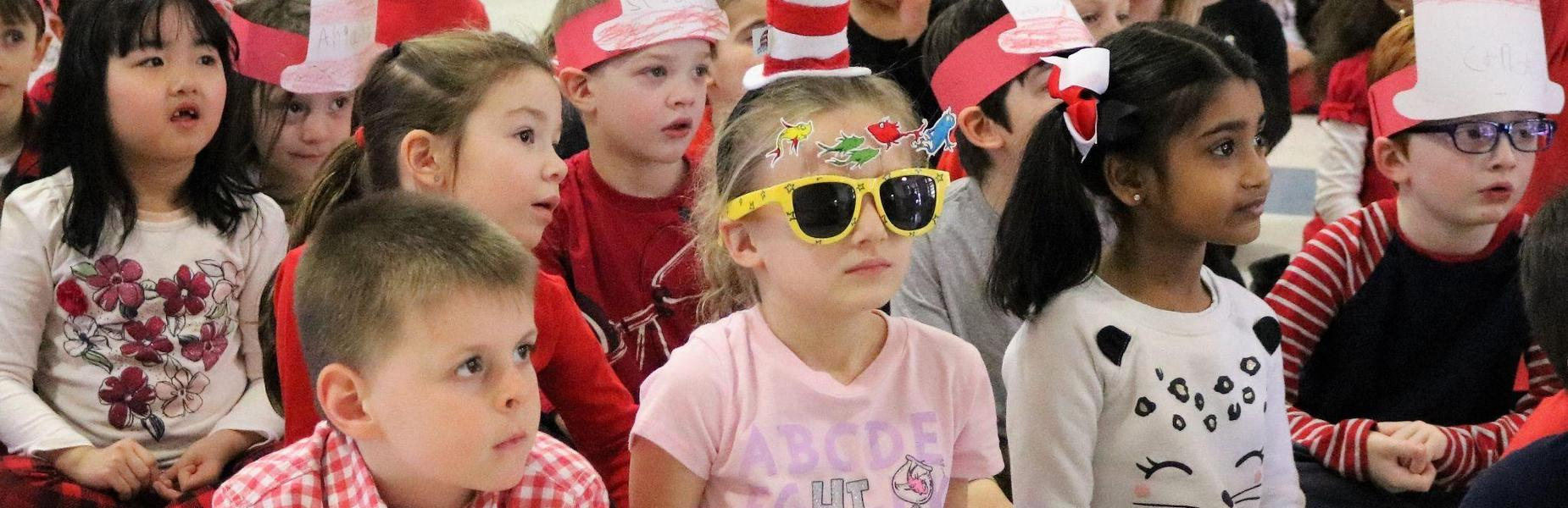 Photo of kindergartners at Lincoln School dressed in Dr. Seuss-inspired garb to celebrate Read Across America Day.