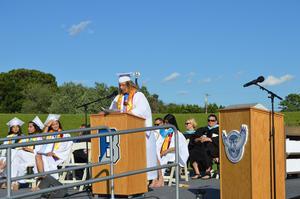 Class President Meghan Klaiss addresses her classmates
