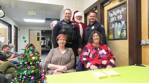 District staff and Nampa police officers greet guests at the front desk.