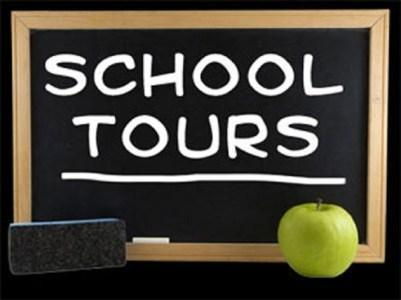 sign on chalkboard that says school tours with an apple