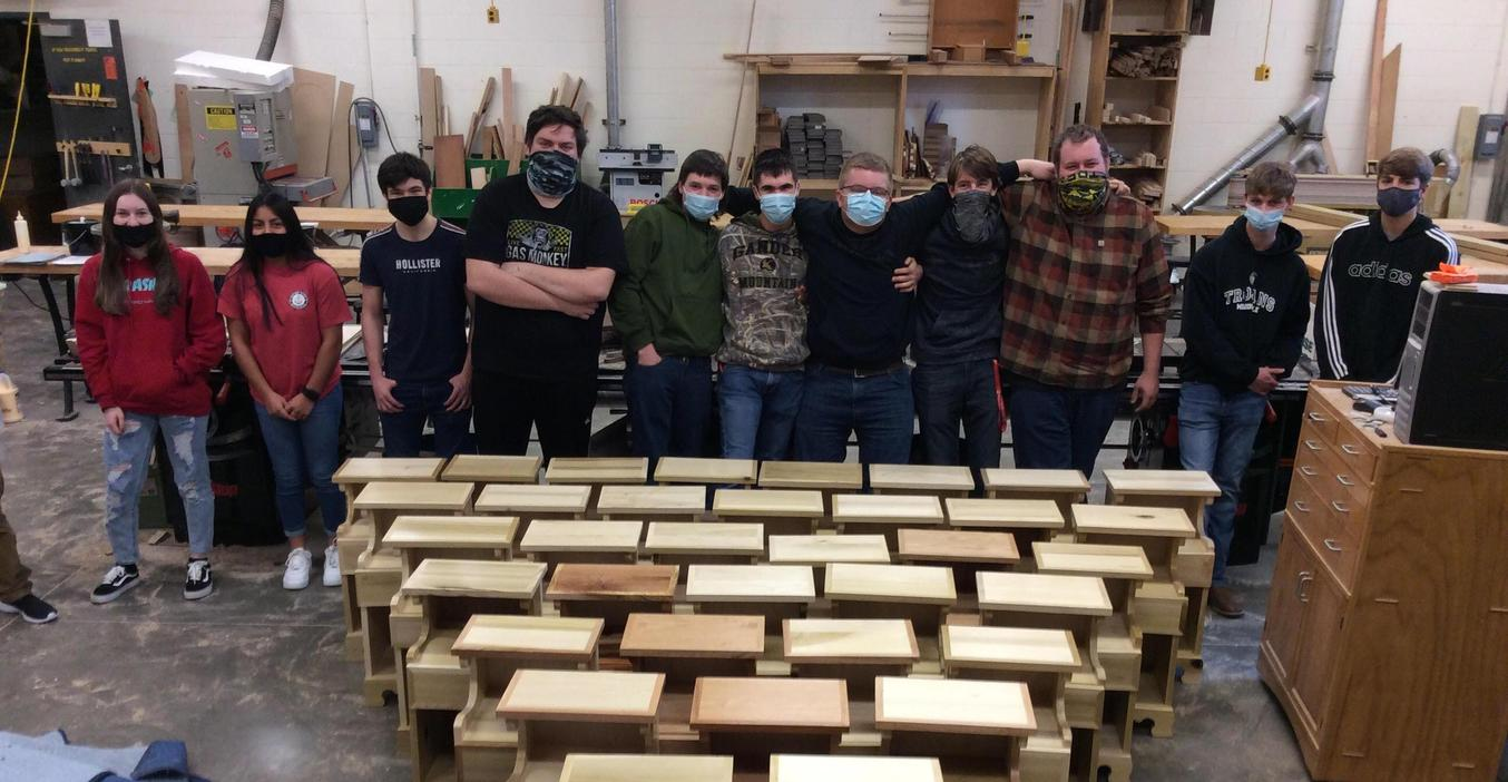 Advanced woods students put the finishing touches on Woods 1 projects after the school had to close for a time.