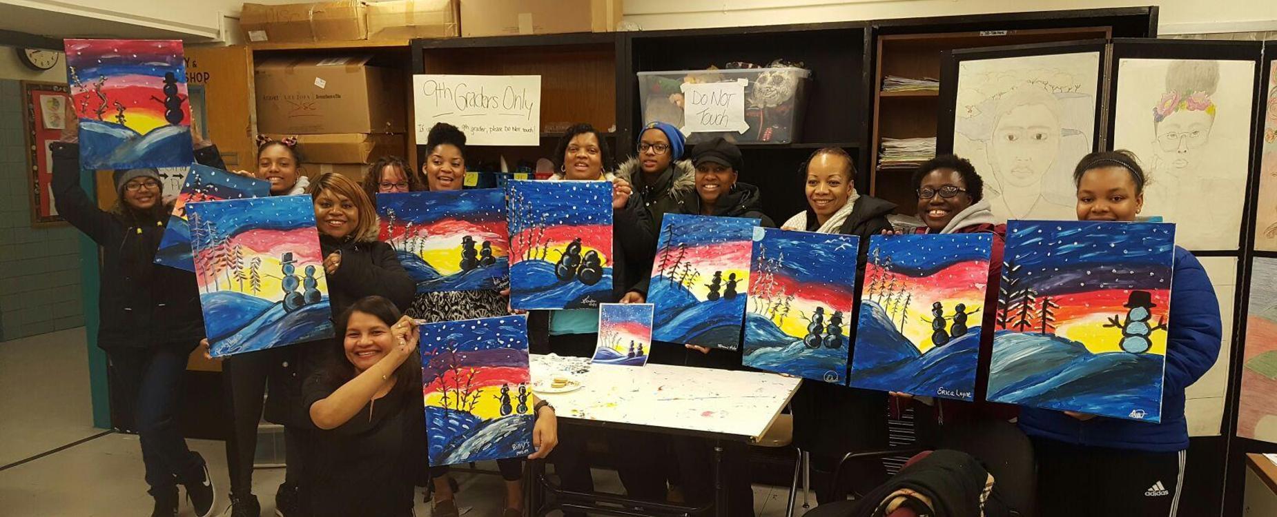 Yeca families enjoying family paint night