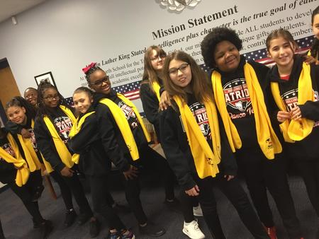 Picture of NSCW dancers in front of LHS mission Statement.