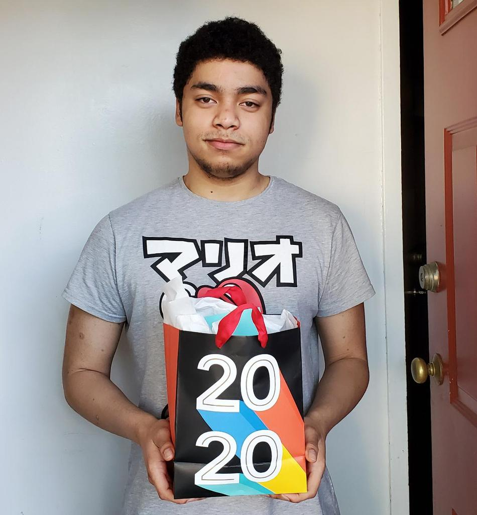 Student holding a gift bag
