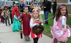 Lincoln School kindergartners show off their costumes to smiling parents and other family members during their Halloween Parade on Oct. 26.