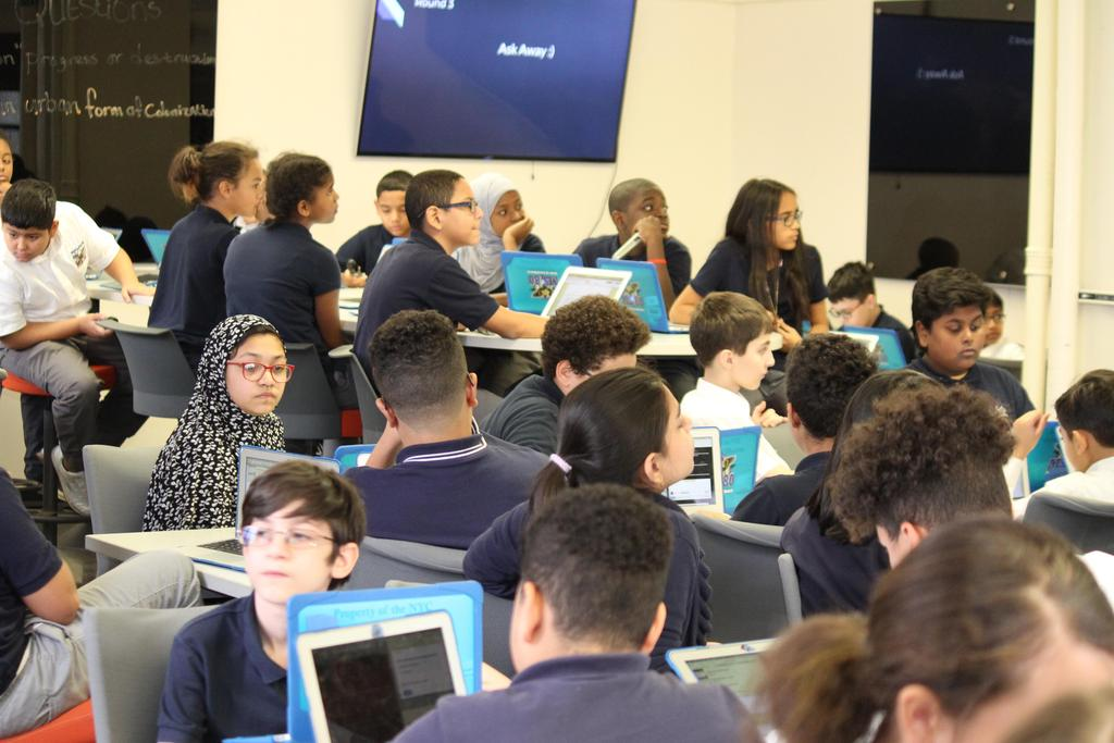 wide shot of the room with students.