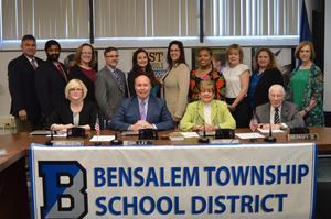 5 men and 9 women. members of the Bensalem Board of School Directors