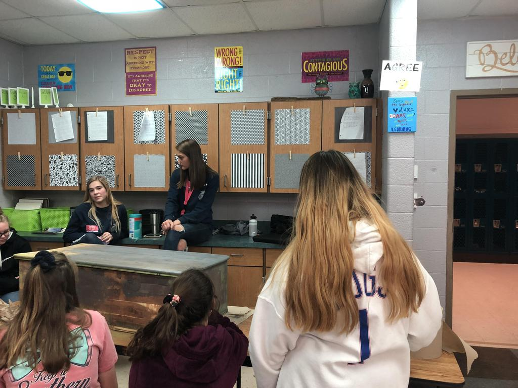 High school ag students teach about sanding and staining