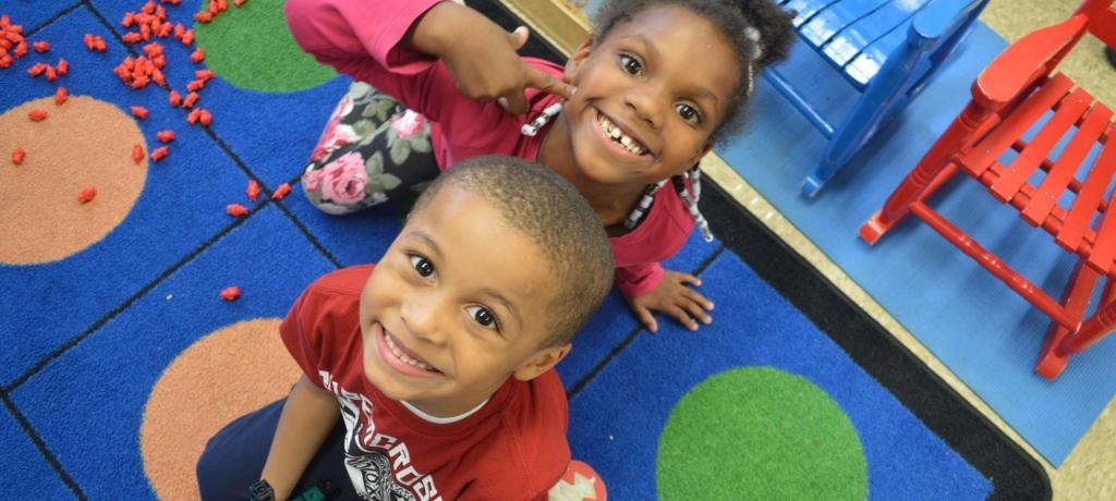 kindergartners smile for the camera