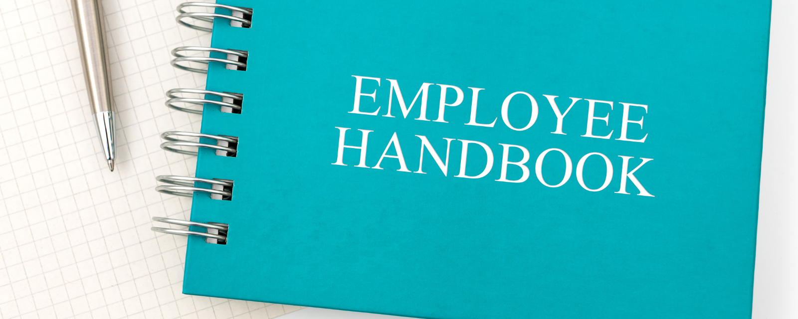 spiral with employee handbook on the cover