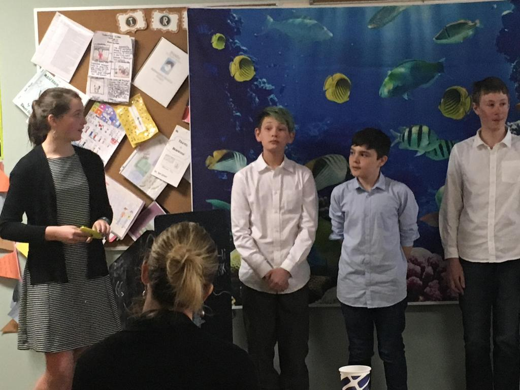 Sixth graders present their inventions to a Shark Tank Panel of parent volunteers.