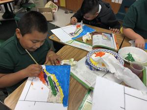 Students carefully painted the regions onto their dried salt dough, image 1