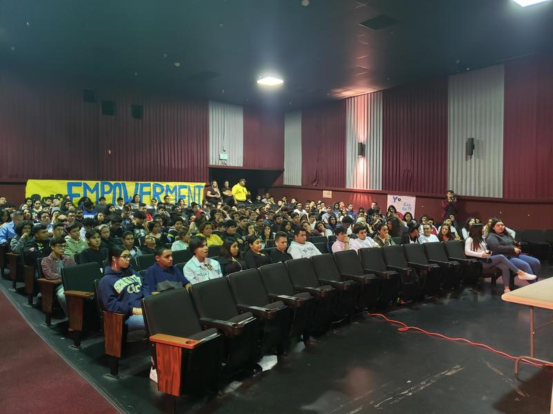Student seated at the assembly