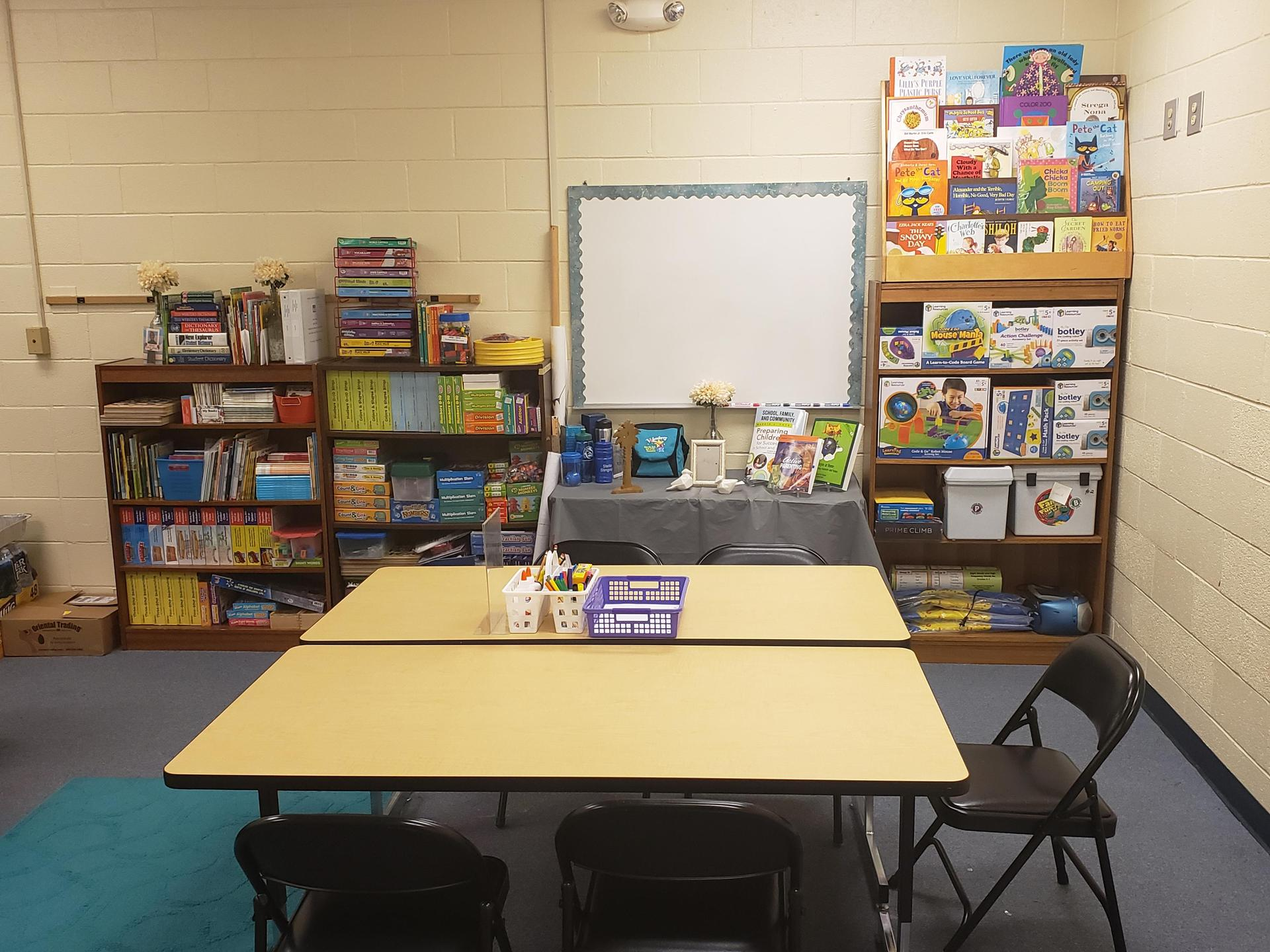 Chairs and Tables arranged in front of bookshelves