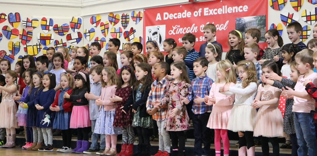 Photo of Lincoln School kindergartners performing for grandparents and special guests.