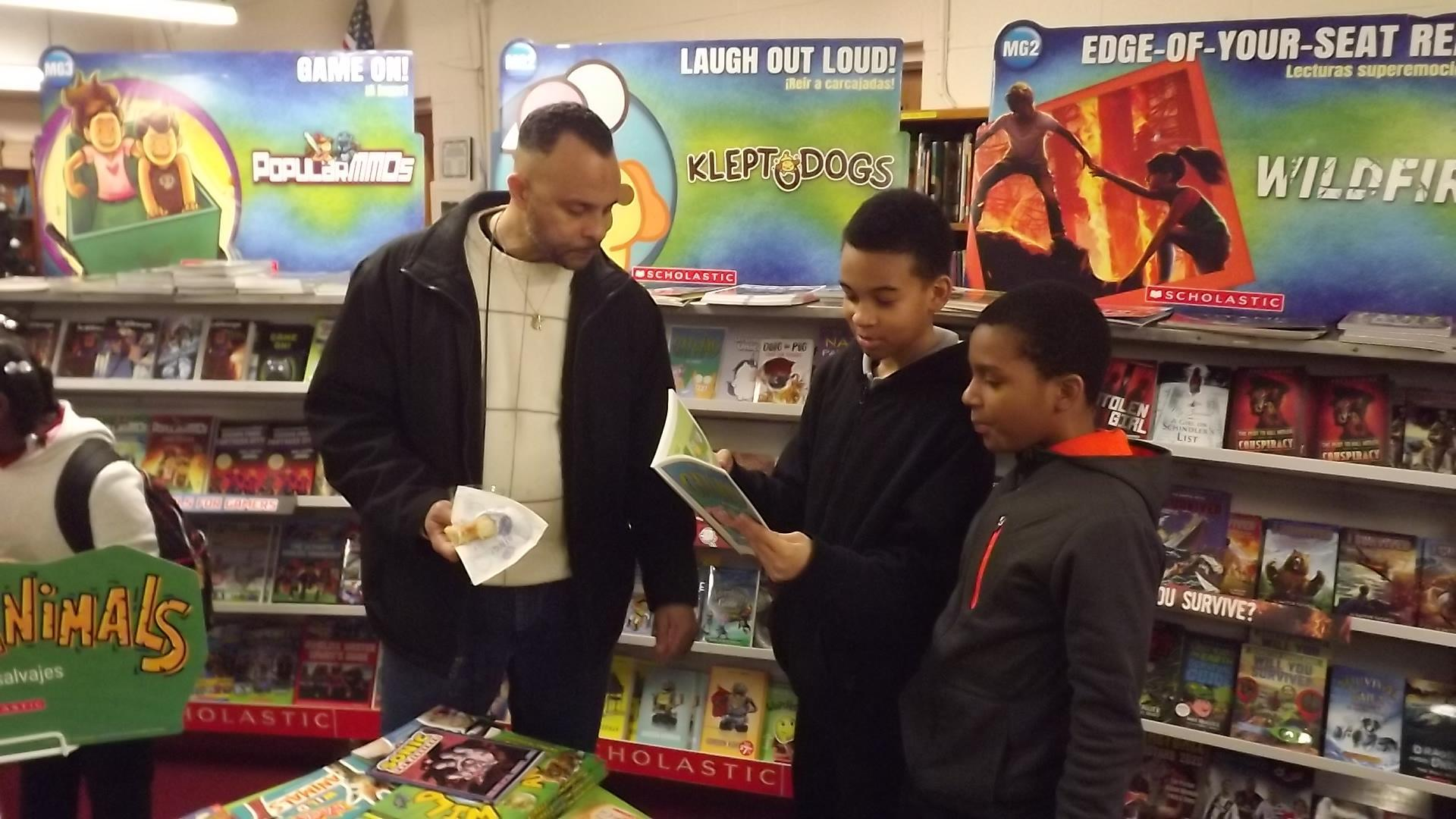 photo of PRAMS dads and kids during scholastic's 2020 Spring Book Fair - Donuts with Dads